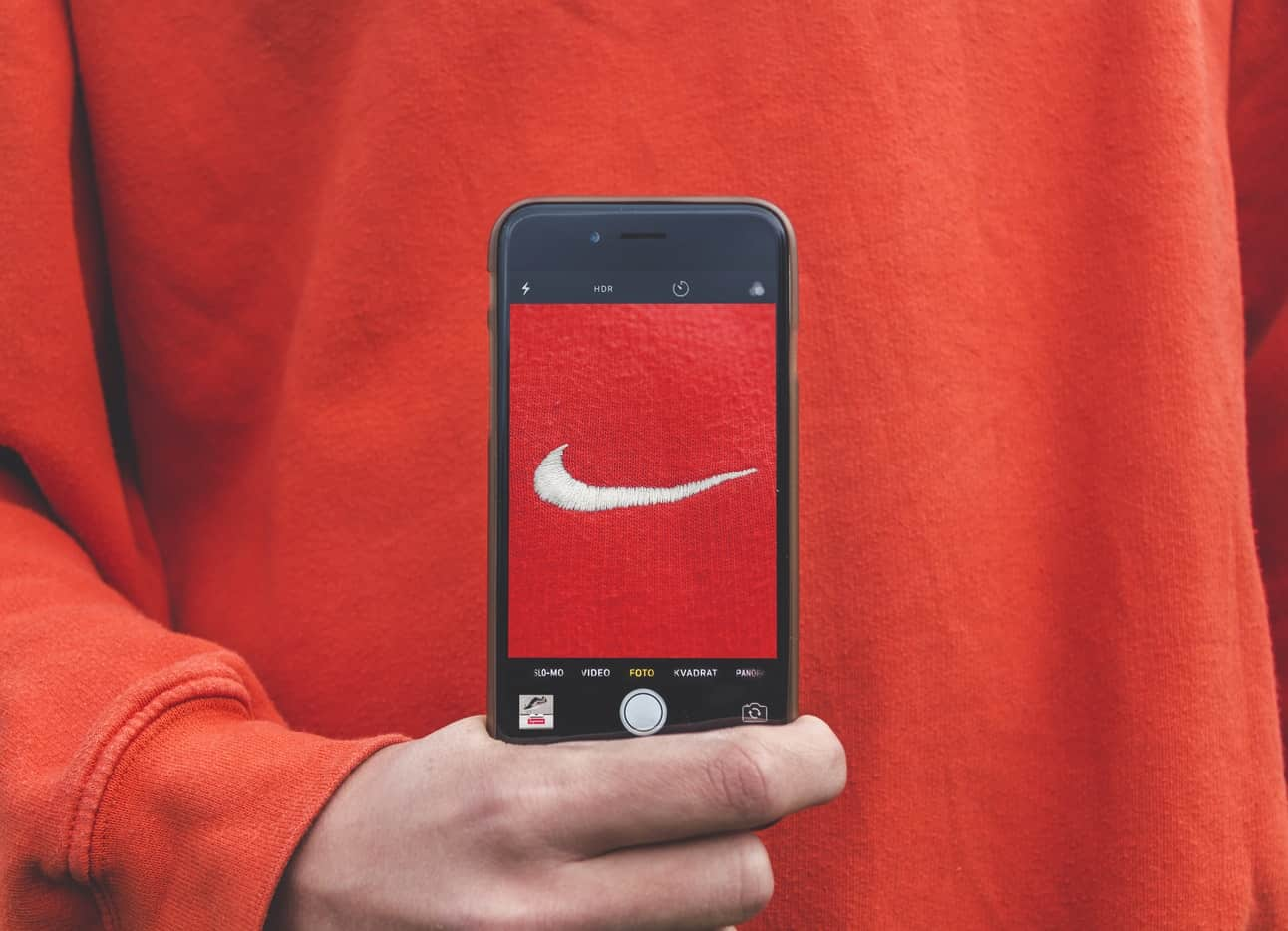 Nike logo in a smartphone screen - brand image